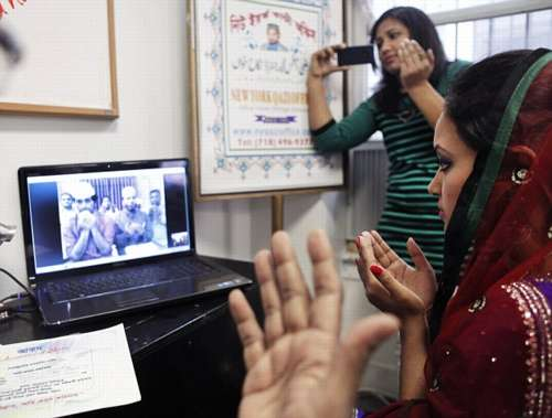 Punam Chowdhury prays during her Skype wedding.