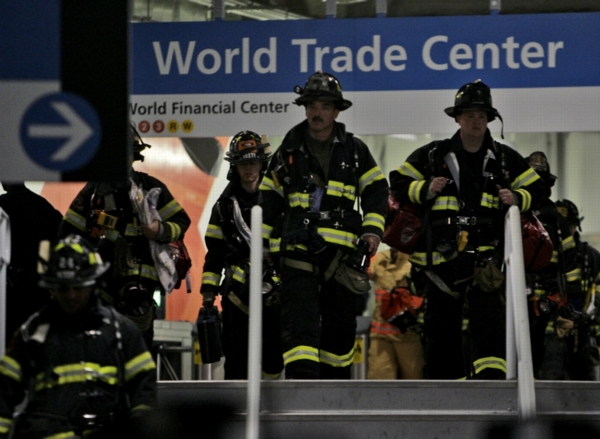 NEW YORK – Emergency responders proceed into the PATH train station during an emergency drill staged at the World Trade Center site on May 17, 2009 in New York City. The drill simulated an explosion involving a PATH commuter train in an underground tunnel between New York and New Jersey and involved more than 800 emergency services' first responders. (Photo by Seth Wenig-Pool/Getty Images)