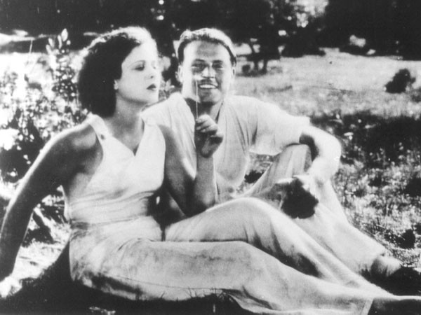 """Photo: Hedy Lamarr with costar Aribert Mog in the 1933 Czech film """"Ecstasy."""" Not long before this scene, Mog returned Hedy's jumper to her after she ran around the fields in the nude, chasing her horse."""