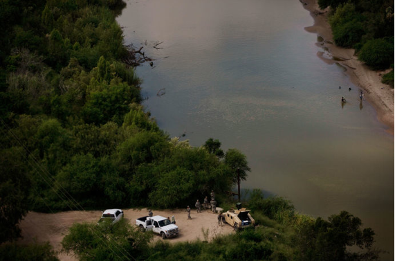 In the Rio Grande Valley of Texas, border agents (pictured here alongside a temporarily deployed National Guard unit) patrol the area for undocumented immigrants entering from Mexico. Credit Photograph by Kirsten Luce