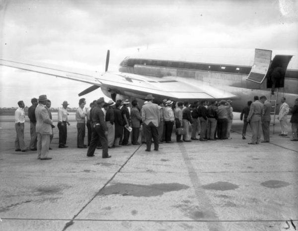 Fifty Mexican people board a U.S. Border Patrol plane on Sept. 21, 1954, as they are deported from Midway Airport, Chicago, IL. The group was flown to Brownsville, TX. where they were put on a boat for Veracruz, Mexico. — Chicago Tribune
